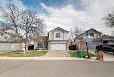 Four bedroom Broomfield home in the The Trails neighborhood backing to open space.