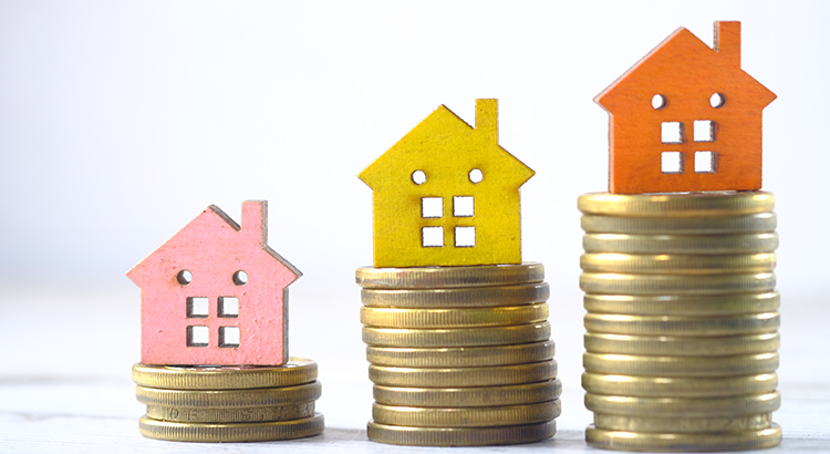 Wooden House On Stock Of Coins,House Finance Concept .
